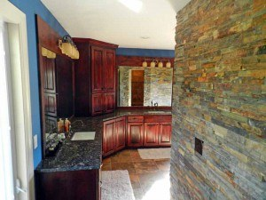 a basement remodel in Olathe Kansas that follows recent trends of using native stone