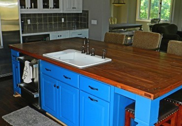 A Johnson County Home is remodeled with a bright blue kitchen as part of emerging remodeling trends in the county